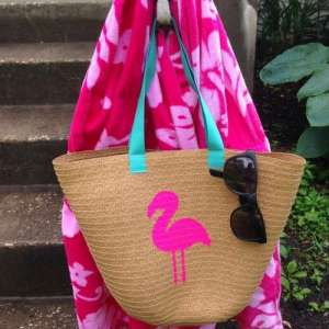 Straw beach bags in colorful pompoms and fringes