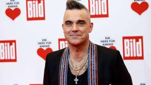 Robbie Williams : le chanteur s'achète une villa à 27 millions d'euros et s'installe en Suisse