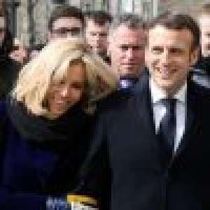 Brigitte et Emmanuel Macron câlins et joyeux sur les Champs-Elysées
