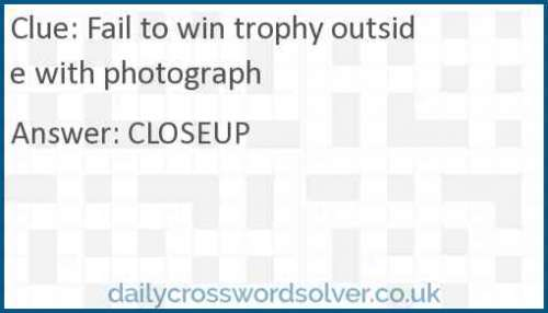 Fail to win trophy outside with photograph crossword answer