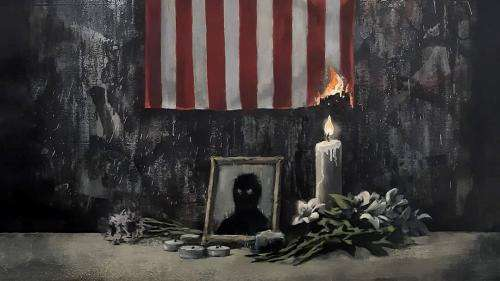 En hommage à George Floyd, le street artist Banksy publie une œuvre d'art avec un drapeau américain en feu